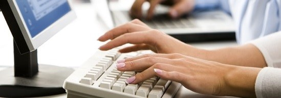 Image of woman typing on keyboard